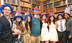 Image of students wearing american hats.